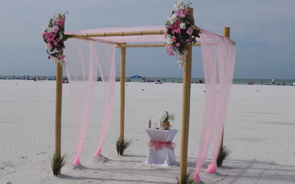 Pink fabric 4 post beach wedding arch package for Sarasota Florida Image 1