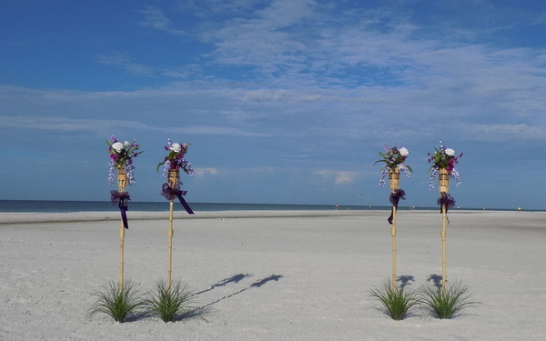 Purple Tiki & Flower Beach Wedding Decorations