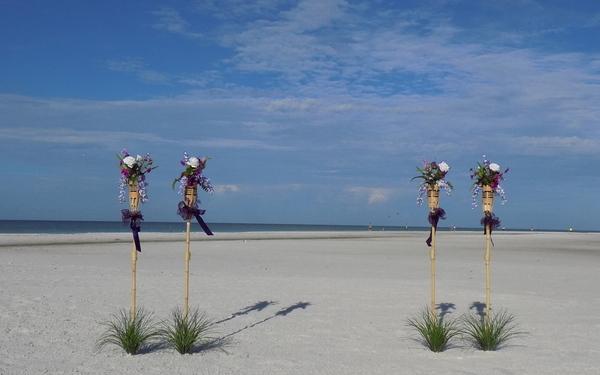 Purple Tiki & Flower Beach Wedding Decorations